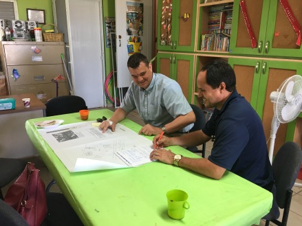 Jim Tinjum and Carlos Velazquez discussing the plans for installation of rooftop solar at the Hogar