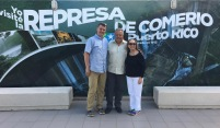 Jim Tinjum (left) and Lydia Rosario (right) with the Mayor of Comerío
